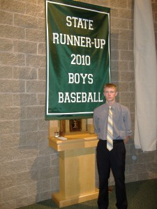 Mattie DeDoes - Captain of 2010 State Finalists, with the banner for Gabriel Richard (Ann Arbor) High School